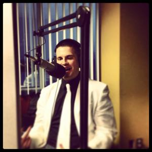 Doing some radio, dressed as a gentleman.